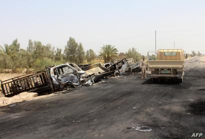 سيارات تابعة لداعش بعد قصفها في الفلوجة