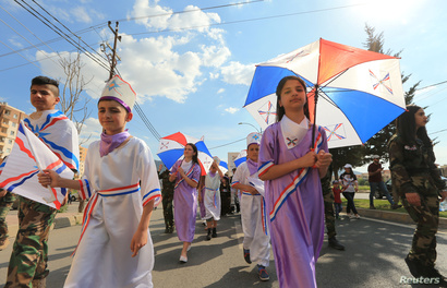 Assyrian Christians celebrate during the anniversary of Akitu, which marked the beginning of the new year in the ancient…