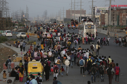 Indian migrant workers walk along an expressway to their villages following a lockdown amid concern over spread of coronavirus…