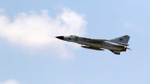 (FILES) In this file photo taken on September 04, 2016 in the coastal city of Misrata shows a MIG-23 fighter jet of the Libyan…
