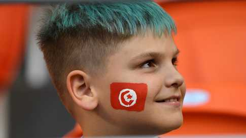 A young Tunisia's supporter waits ahead of the Russia 2018 World Cup Group G football match between Panama and Tunisia at the…