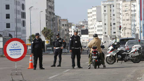 Police officers control a motorist in Casablanca, Morocco, Friday March 27, 2020. The Moroccan government allowed people to…