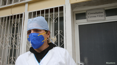 A member of the medical personnel wearing a protective face mask is pictured in Hospital in Algiers, Algeria  March 16, 2020…