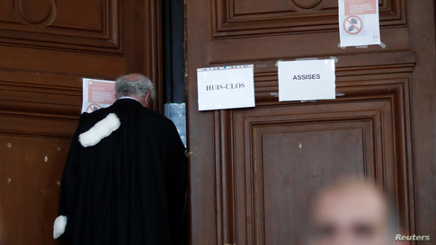 """The message """"behind closed doors"""" is pictured on the door of the courtroom at the opening of the trial of retired French…"""