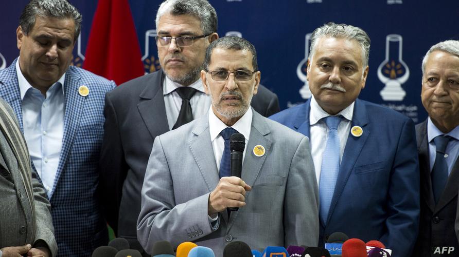 زعماء أحزاب الأغلبية الحكومية خلال إعلان اتفاقهم على تشكيل الحكومة