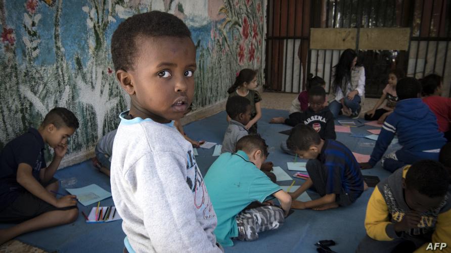 أطفال لاجئون بالعاصمة الليبية طرابلس