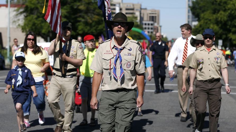 Members of the Boys Scouts of America march in a gay pride parade in Salt Lake City, Utah, June 2, 2013. Both active Mormons…