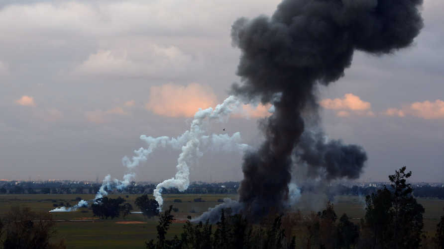 A picture taken on February 10, 2015 in Tripoli shows smoke billowing after members of the Military College of Engineering of…