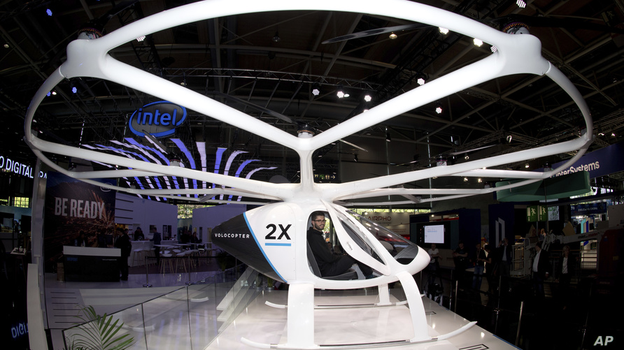 FILE -In this Monday, June 11, 2018 file photo, the multi-rotor electric aircraft Volocopter 2x, displayed at the electronic…