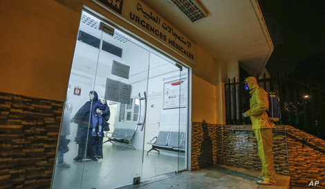 In this photo taken late Friday, March 20, 2020, workers disinfect a hospital to prevent the spread of coronavirus in Algiers,…