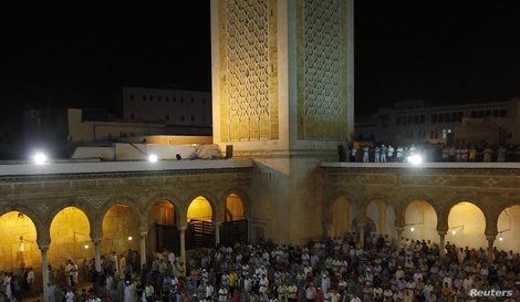 Muslims conduct taraweeh prayers as they gather specially for Lailat al-Qadr, at Al Zitouna mosque in Tunis July 24, 2014…