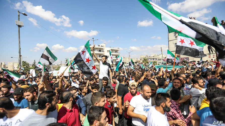 تظاهرة معارضة للنظام السوري في إدلب