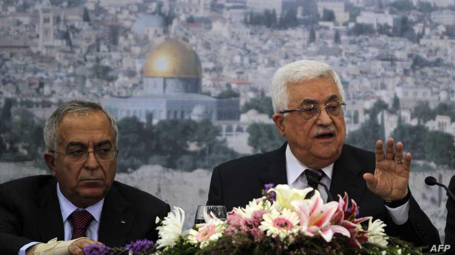 رئيس السلطة الفلسطينية محمود عباس ورئيس الحكومة سلام فياض