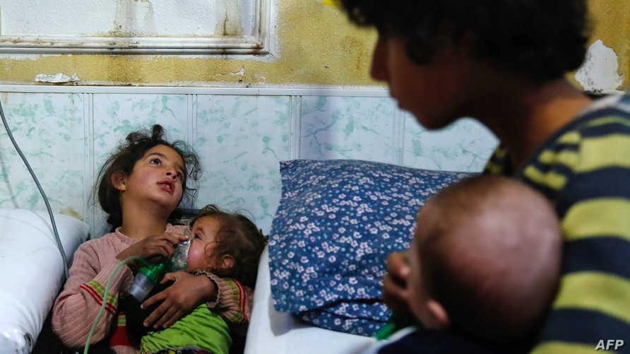 مصابون باختناقات في ما يشتبه بكونه هجوما بالأسلحة الكيميائية في الغوطة الشرقية-أرشيف