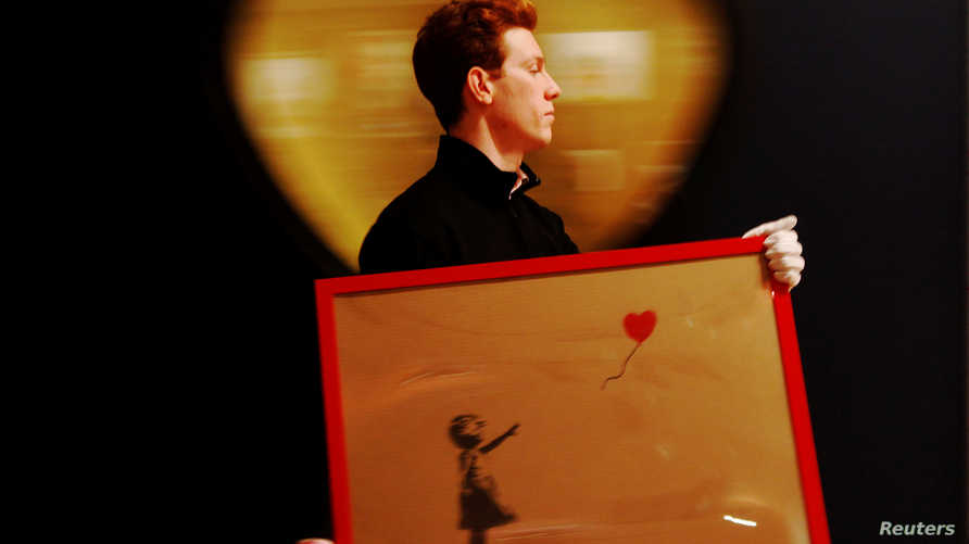 لوحة الفتاة والبالون التي مزقت نفسها بعد بيعها بـ 1.4 مليون دولار