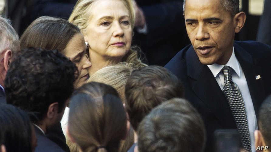 الرئيس أوباما ووزيرة الخارجية هيلاري كلينتون موظفي وزارة الخارجية