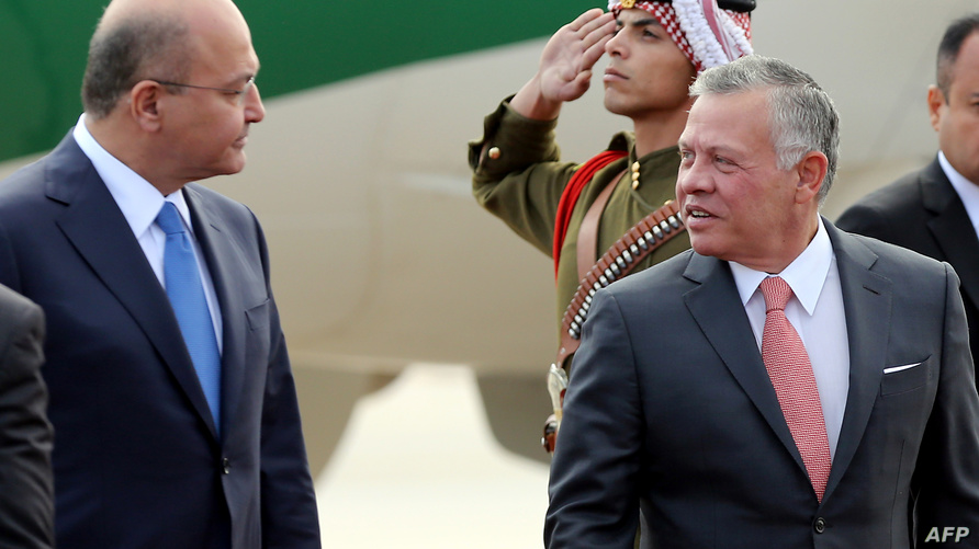 العاهل الأردني والرئيس العراقي خلال لقاء في عمان
