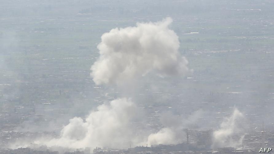 سحب دخان إثر تعرض دوما لقصف-أرشيف