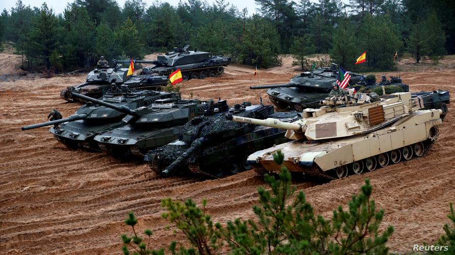قوات أميركية وألمانية وإسبانية وبولندية في إطار الاستعداد لتدريب مشترك لقوات حلف شمال الأطلسي (الناتو)