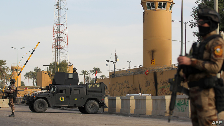 قوات عراقية أمام مبنى السفارة الأميركية في العراق
