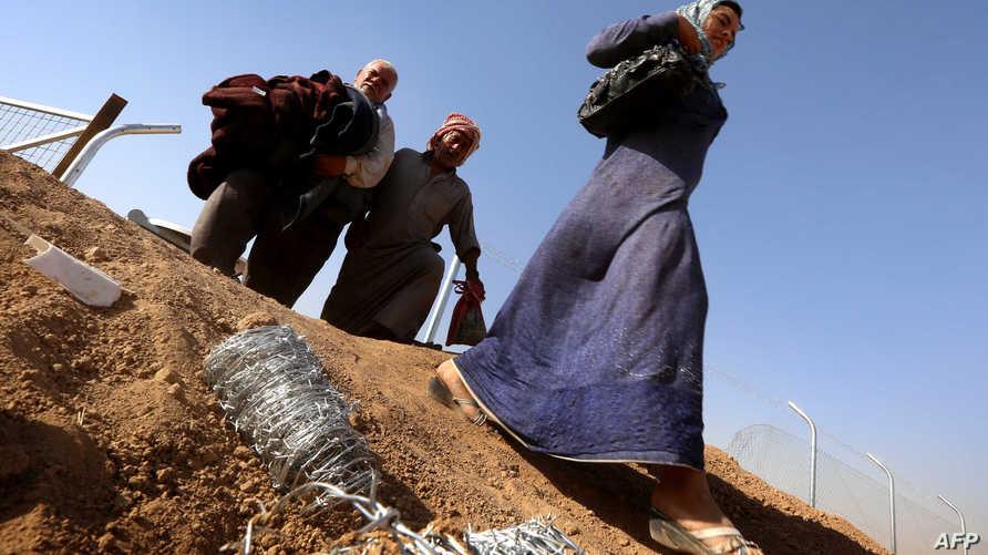 عائلة تركمانية تفر من مدينة تلعفر إلى مخيم خازر بالقرب من أربيل