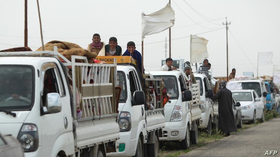 نازحون من مناطق غرب سامراء في محافظة صلاح الدين/وكالة الصحافة الفرنسية