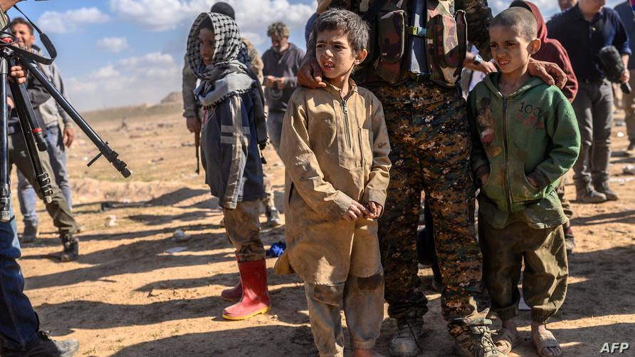 أطفال أيزيديون تم تحريرهم من داعش في الباغوز/ ا ف ب