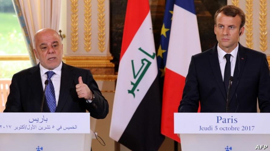 ماكرون والعبادي خلال المؤتمر الصحافي في باريس